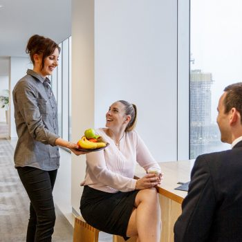 brew hub valet offering fresh fruit to the staff - Office catering