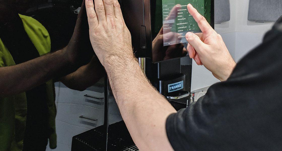 A BrewHub Technician servicing an Office coffee machine.