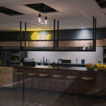 View of Oasis, the new central hub for CBH employees with island bench, fridges, cupboards, fruits and TopBrewer coffee machines