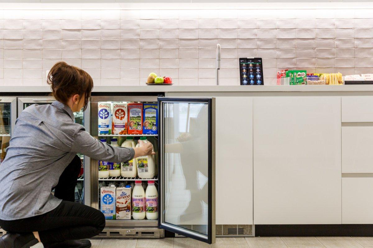 BrewHub Valet stocking milk in fridge