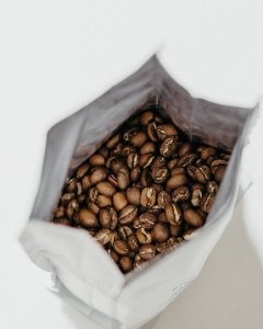Coffee beans inside a white bag package
